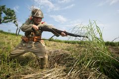 Japanese soldiers-reenactors reproduce the attack on the Soviet army during the Second World War stock images
