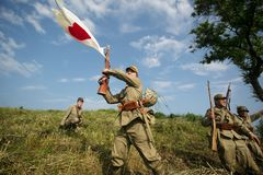 Japanese soldiers-reenactors reproduce the attack on the Soviet army during the Second World War. August 10, 2013, Primorsky Krai - Japanese soldiers-reenactors royalty free stock photos