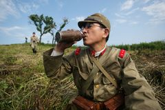 Japanese soldiers-reenactors reproduce the attack on the Soviet army during the Second World War. August 10, 2013, Primorsky Krai - Japanese soldiers-reenactors royalty free stock photo