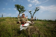 Japanese soldiers-reenactors reproduce the attack on the Soviet army during the Second World War. August 10, 2013, Primorsky Krai - Japanese soldiers-reenactors royalty free stock image