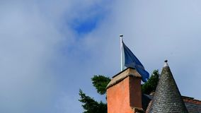 Flag of Scotland. August 2017: Scottish flag waves in the wind above a castle on a summer day. August 2017 in Alford stock footage