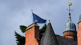 Flag of Scotland. August 2017: Scottish flag waves in the wind above a castle on a summer day. August 2017 in Alford stock video footage