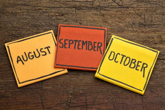August, September and October on sticky notes Royalty Free Stock Images
