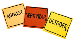 August, September and October on sticky notes Stock Image