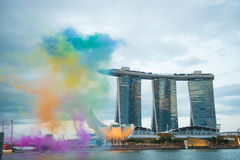 August 9, 2014: Singapore National Day. Colored smoke emission and the Sands Hotel royalty free stock photo