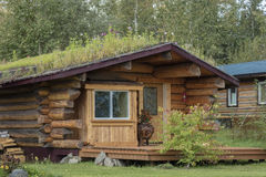 AUGUST 25, 2016 - A sod roof log cabin Nenana Alaska south of Fairbanks Stock Photos