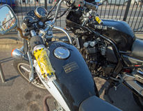 August 2017, Southend On Sea, Motorcycles issued with parking tickets. Two motorcycles parked on the pavement at Southend On Sea, Essex, England have been issued Royalty Free Stock Image