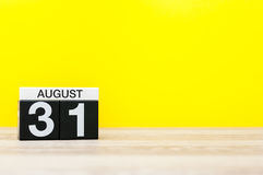 August 31st. Image of august 31, calendar on yellow background with empty space for text. Summer time end. Back to Stock Photography