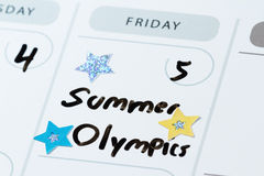 August 5 Summer olympics opening day. Close up of a daily planner or calendar with a hand written message for a celebration or holiday like the beginning of the Royalty Free Stock Image