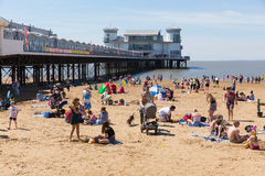 August summer sunshine at the beach and pier Weston-super-Mare Somerset. Beautiful summer sunshine and warm weather drew visitors to the seaside at Weston-super Stock Photo
