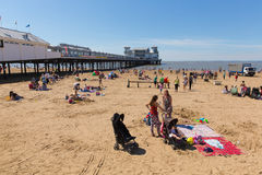 August summer sunshine at the beach Weston-super-Mare Somerset. Beautiful summer sunshine and warm weather drew visitors to the seaside at Weston-super-Mare Royalty Free Stock Images
