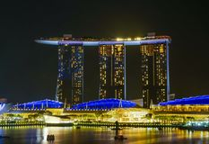 Marina Bay Sands hotel and bay waterfront dressed in beautiful lights at night ready to celebrate the country National Day royalty free stock photo