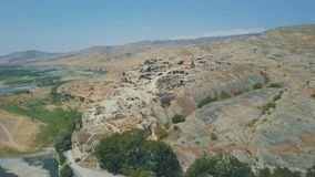 10 August, 2017 - Uplistsikhe, an ancient rock-hewn town near Gori in Georgia. 10 August, 2017 - Panoramic view of Uplistsikhe, an ancient rock-hewn town near stock video footage