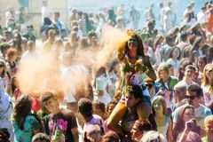 Young, decorated people participate in the Holi festival of colors in Vladivostok. royalty free stock images