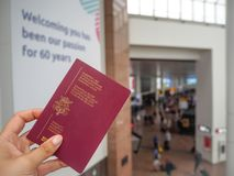 August 2018 - Zaventem, Belgium: Female caucasian hand holding a. Belgian passport at the check-in hall of the Brussels airport, Belgium`s main airport stock photography