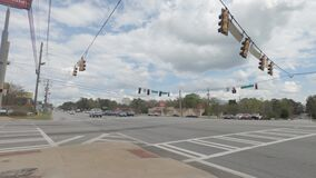 Traffic at a 4 way intersection and Family Dollar in view Traffic signals