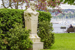 Auguste Niederhausern. GENEVA, SWITZERLAND - MAY 21, 2013: Marble bust and pedestal made in one piece of the Swiss sculptor Auguste Niederhausern better known as Stock Photography
