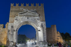 Augustus Arch and 20th September 1870 Street in Rimini, Italy. Arch of Augustus and 20th September 1870 Street at night. Ancient romanesque gate of city Stock Image