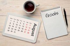 Augustus-kalendernet en doelstellingen Stock Foto