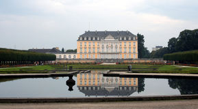 Augustusburg Palace, Germany. Augustusburg Palace reflected in a water fountain, near Bruhl Germany Royalty Free Stock Photos