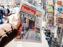 Aujord`hui reporting handover ceremony presidential inauguration. PARIS, FRANCE - MAY 15, 2017: Man buys Aujord`hui French newspaper reporting handover ceremony Stock Image
