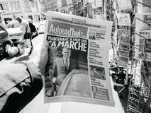 Aujord`hui reporting handover ceremony presidential inauguration. PARIS, FRANCE - MAY 15, 2017: Man buys Aujord`hui French newspaper reporting handover ceremony Stock Photography
