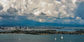 Aukland's Impending Storm. The city of Aukland, New Zealand, as seen from Rangitoto Island, with a storm approaching in the distance Stock Images