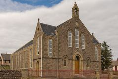 Aultbea Christian Congregation Church in NW Scotland. Aultbea, Scotland - June 9, 2012: Christian Congregation Church is brown stone building with small turret royalty free stock images