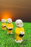 Aumône de moines de stuc photos libres de droits