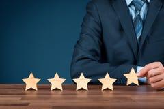 Aumente estrelas da avaliação cinco imagens de stock royalty free