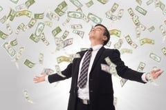 Aumento del dinero Felicidad del hombre de negocios Foto de archivo