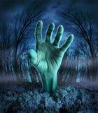Aumento della mano dello zombie Fotografia Stock Libera da Diritti