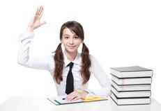 Aumento della ragazza del banco una mano Fotografie Stock Libere da Diritti