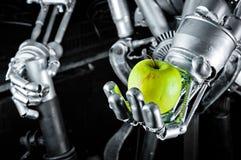 äpple - green hands roboten fotografering för bildbyråer