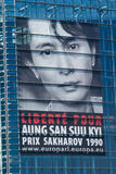 Aung san suu kyi free request poster. European Parliament buildings in Brussels campaign poster to free Aung San Suu KYI Sakharov Prize 1990 Aung San Suu Kyi is Royalty Free Stock Images