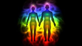 Aura and chakras - silhouette of woman and man stock video footage