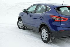 Aura, Finland - February 2, 2019: New Nissan Qashqai 2019 model color ink blue on snow. royalty free stock photos