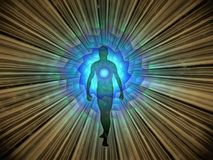 Aura. Man`s silhouette with rays of light Royalty Free Stock Photo