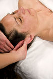 Auricle massage Royalty Free Stock Photo