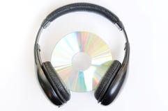 Auricular con CD Fotografía de archivo libre de regalías