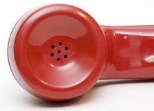 Auricular rotatorio rojo antiguo del teléfono Foto de archivo