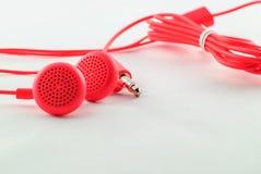 Auriculares atados con alambre rojo Fotografía de archivo libre de regalías