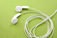 Auriculares blancos Foto de archivo libre de regalías
