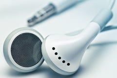 Auriculares blancos Imagen de archivo libre de regalías