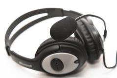 Auriculares con un micrófono Fotografía de archivo