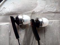 Auriculares de botón Fotografía de archivo