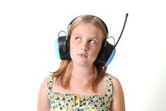 Auriculares de la muchacha Fotografía de archivo libre de regalías