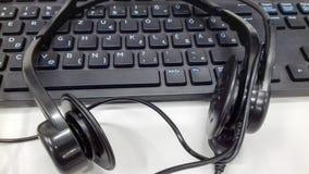 Auriculares do teclado do centro de negócios Fotografia de Stock