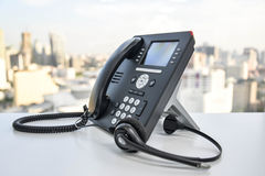 Auriculares e o telefone do IP Fotos de Stock Royalty Free