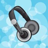 Auriculares en círculos azules Fotos de archivo libres de regalías
